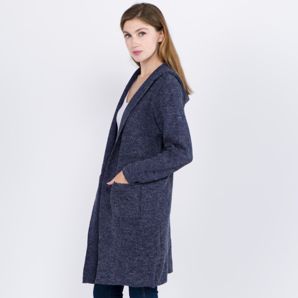 Gorgeous knit like cardigan with hood and front pockets. 55% Acrylic 45% cotton