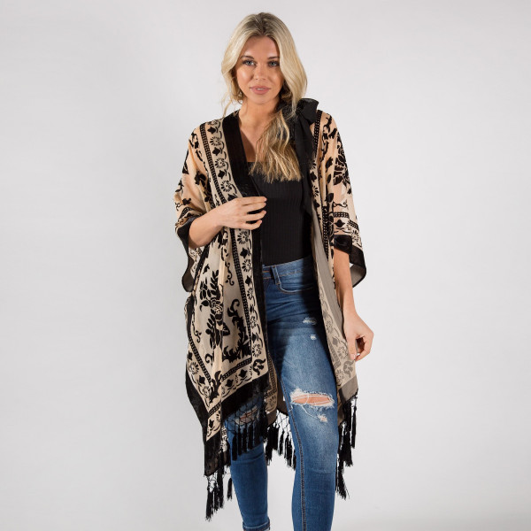 """Black floral kimono with tassels. One size fit most 0-14. Measures approximately 42"""" x 36"""" in size. 50% Viscose, 50% Nylon"""