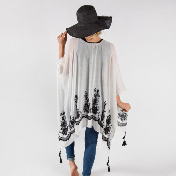 Light weight beach cover up with stitch designs and beaded tassels. 100% polyester.