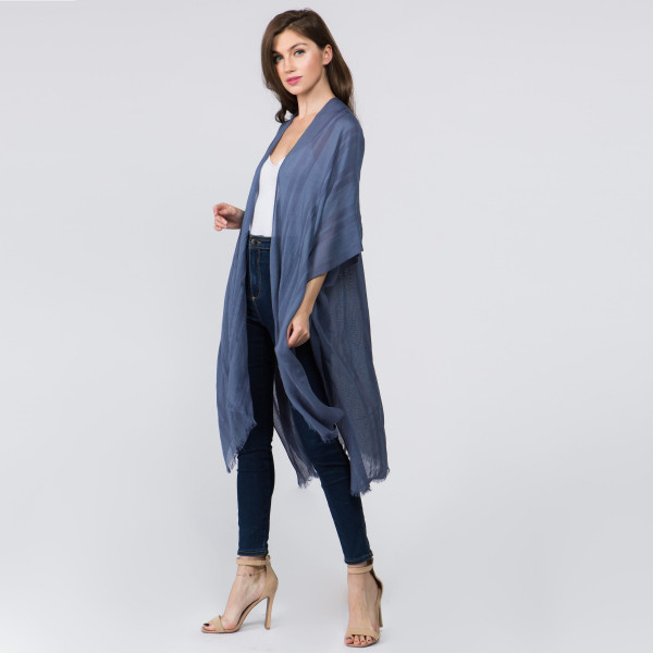 "Lightweight blue kimono. One size fits most 0-14. Measures approximately 41"" x 36"" in size. 80% Cotton, 20% Viscose."