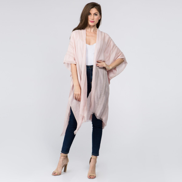 "Lightweight blush kimono. One size fits most 0-14. Measures approximately 41"" x 36"" in size. 80% Cotton, 20% Viscose."