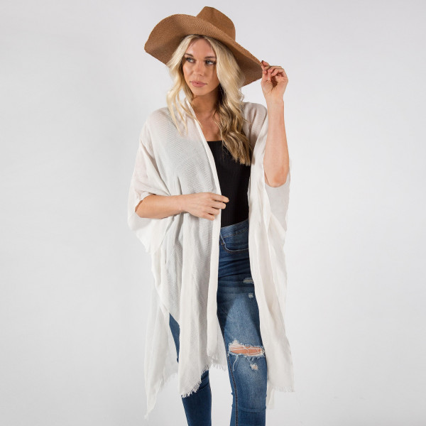 "Lightweight ivory kimono. One size fits most 0-14. Measures approximately 41"" x 36"" in size. 80% Cotton, 20% Viscose."