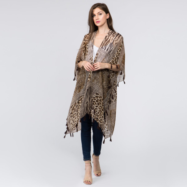 "Lightweight brown animal print kimono with tassels. One size fits most 0-14. Measures approximately 39"" x 36"" in size. 100% Polyester."