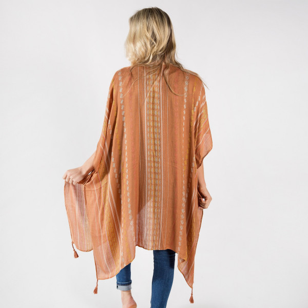 "Lightweight brown kimono with embroidery detailing and tassels. One size fits most 0-14. Measures approximately 41"" x 35"" in size. 100% Viscose."