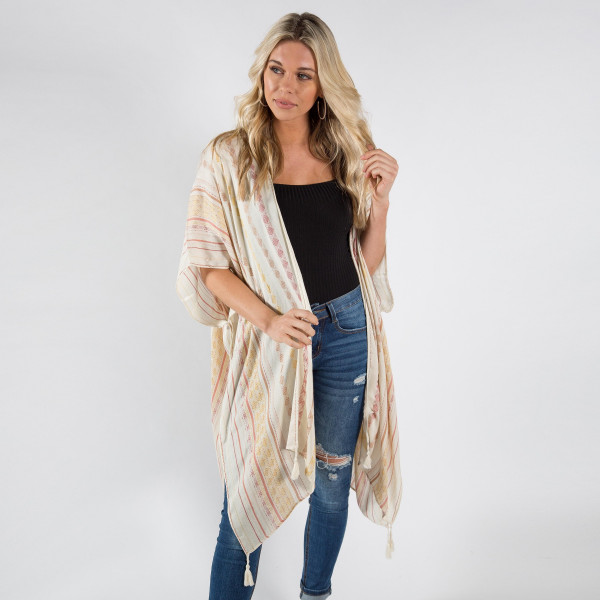 "Lightweight ivory kimono with embroidery detailing and tassels. One size fits most 0-14. Measures approximately 41"" x 35"" in size. 100% Viscose."