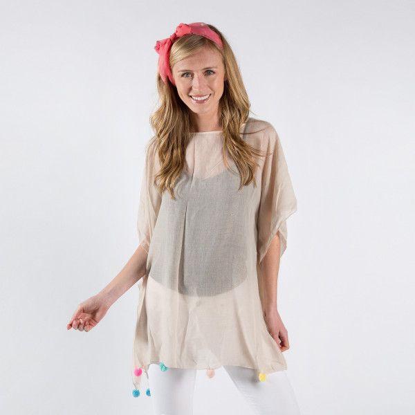Light-weight cover up with ball tassels. 30% cotton-70% polyester.