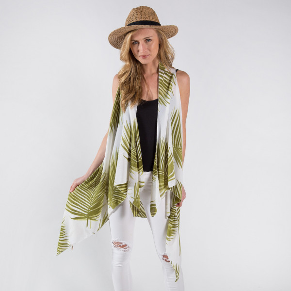Ivory vest/cover up with palm leaves. One size fits most 0-14. 100% polyester.
