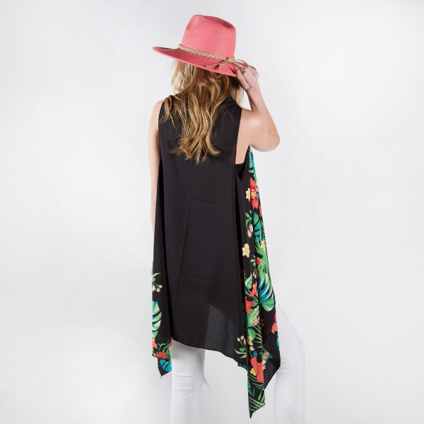 Tropical vest/cover up with palm leaves. One size fits most 0-14. 100% polyester.
