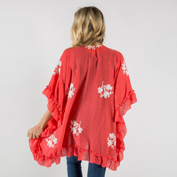 Ruffled kimono with floral details. One size fits most 0-14. Approximate 20% cotton-80% polyester.