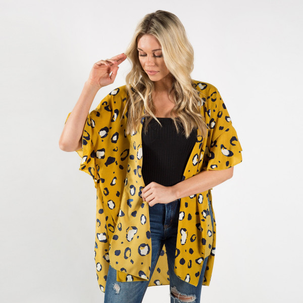 Animal print kimono or cover up. Light weight. 100% polyester.