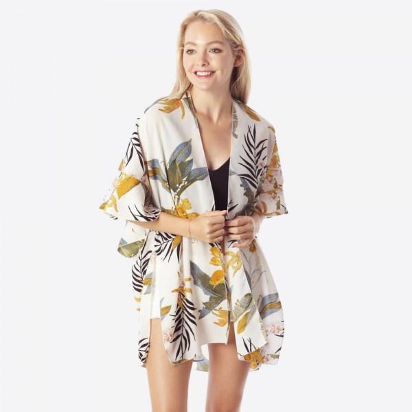 Floral print kimono with ruffles. 100% polyester.
