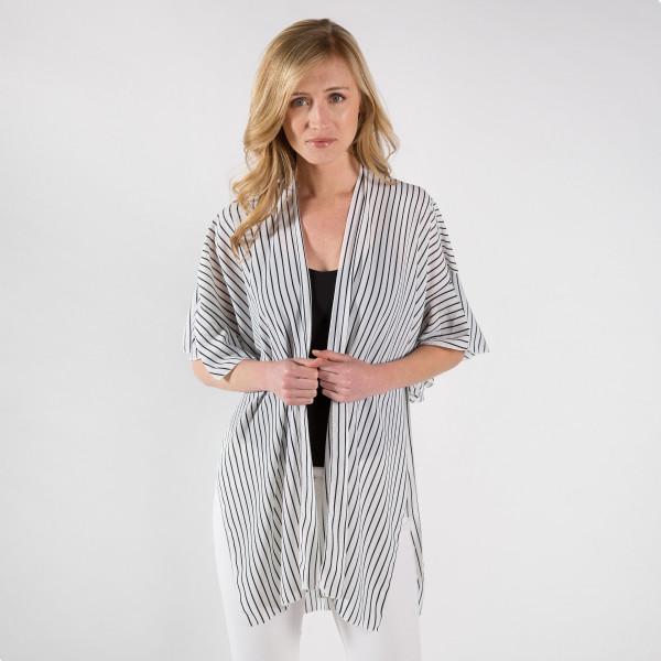 Striped print kimono with ruffles. 100% polyester.