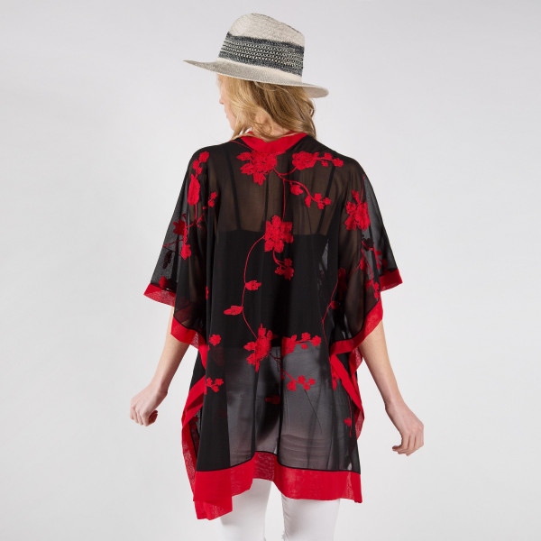 Sheer kimono with stitched floral embroidery. One size fits most 0-14. 100% viscose.