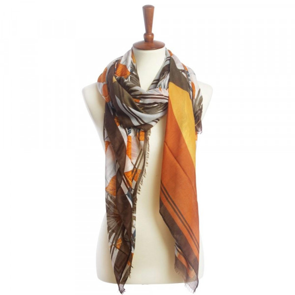 "Light weight tropical leaf scarf with fringes. Approximate 72"" X 20"" in length. 100% polyester"