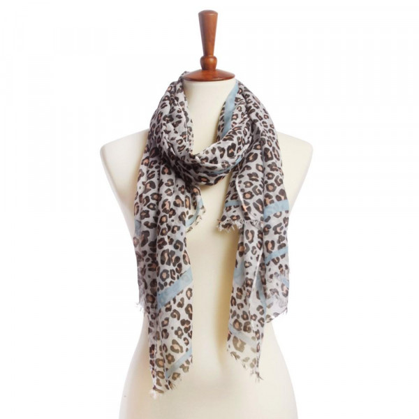 Animal print oblong scarf. 100% polyester.