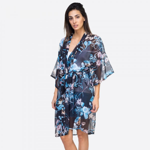"Black lightweight floral print kimono with waist tie. One size fits most 0-14. Measures approximately 30"" x 39"" in size. 100% polyester."