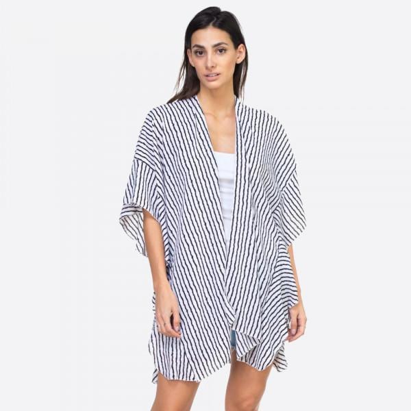 "Vertical striped ruffle kimono.  37""X33"" 100% POLYESTER"