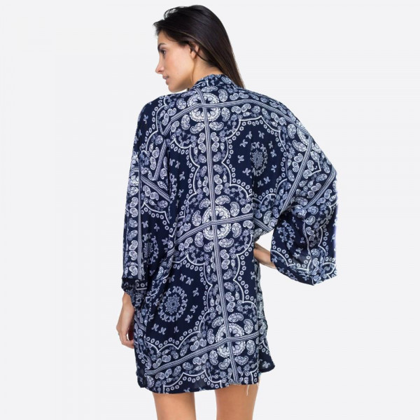 "Navy blue paisley geometric kimono. One size fits most 0-14. Measures approximately 25"" x 36"" in size. 100% Viscose."