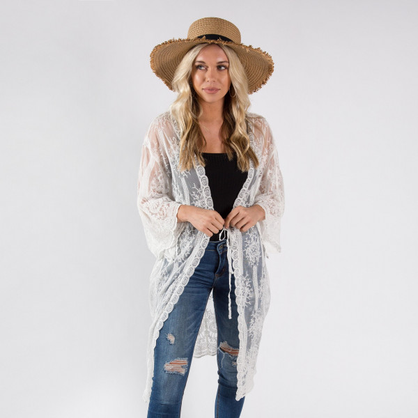 Lightweight white lace kimono with waist tie. One size fit most 0-14. 50% cotton 50% polyester.