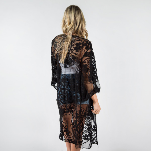 "Lightweight black lace kimono with waist tie. One size fits most 0-14. 35% cotton 65% polyester.  40"" in length."