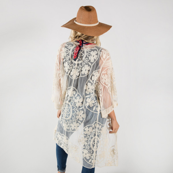 Lightweight ivory flower lace kimono. One size fits most 0-14. 25% cotton-50% polyester.