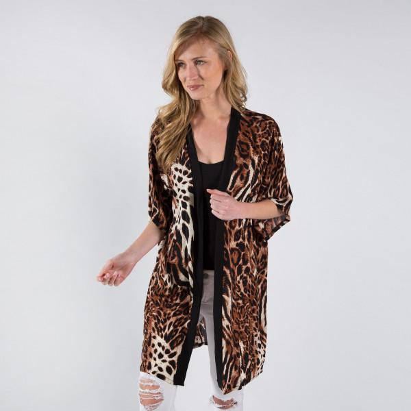 Animal print kimono with black trim border. 100% viscose.