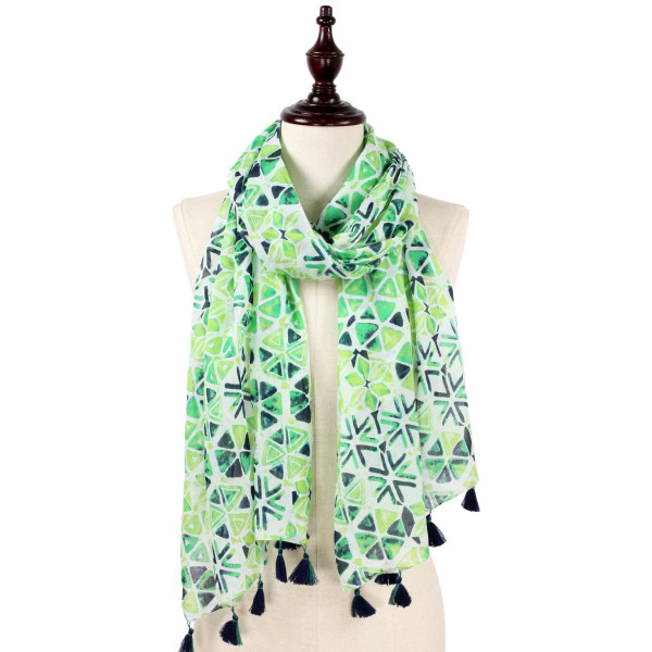 "Abstract print scarf with tassel. Approximate 74"" L X 40"" W. 100% Cotton."