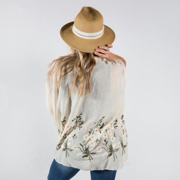 Light weight flower embroidery kimono. 20% cotton-80% polyester.