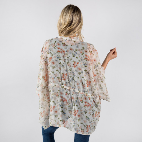 Lightweight white flower chiffon kimono with drawstring. One size fits most 0-14. 100% polyester.
