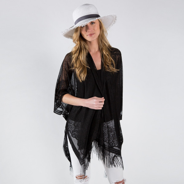 Floral lace kimono with fringe. 100% polyester. One size fits most 0-14.