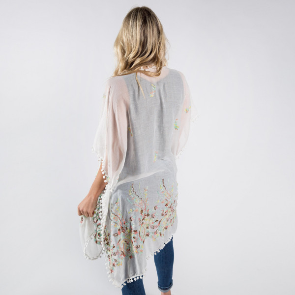 Embroidered flower kimono. One size fits most 0-14. 100% polyester.