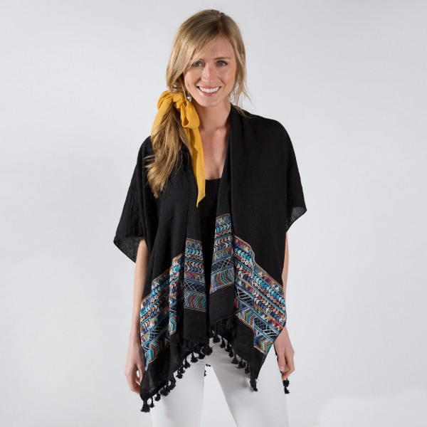 Embroidered kimono with tassels. One size fits most 0-14. 80% polyester, 20% cotton.