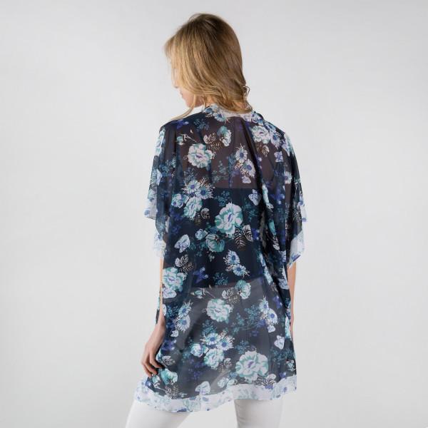 Light weight flower chiffon kimono. 100% polyester. Fits most 0-14.