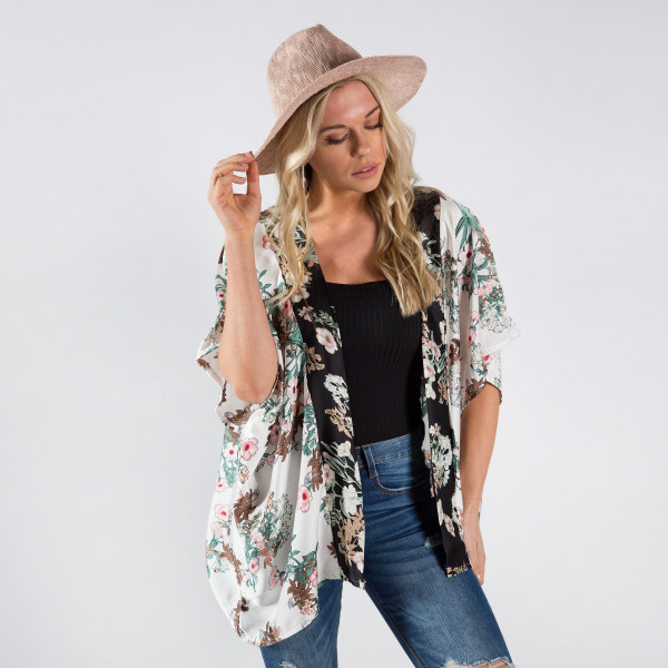 Light weight flower print kimono. 100% polyester.  Fits most 0-14.