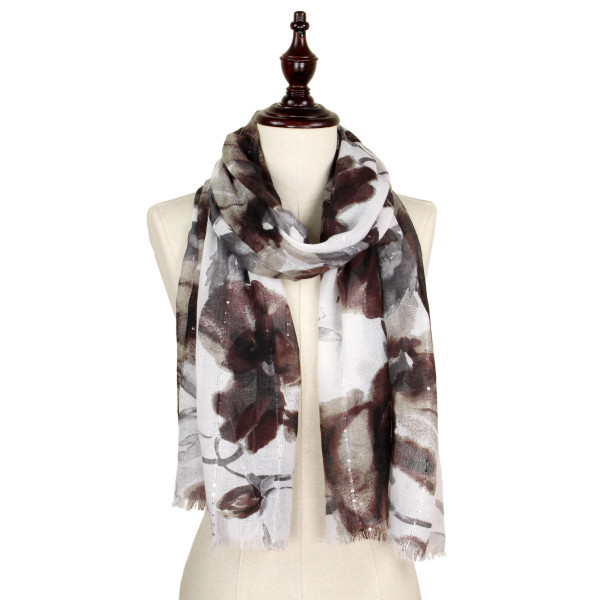 Flower printed scarf with sequins. 100% polyester.