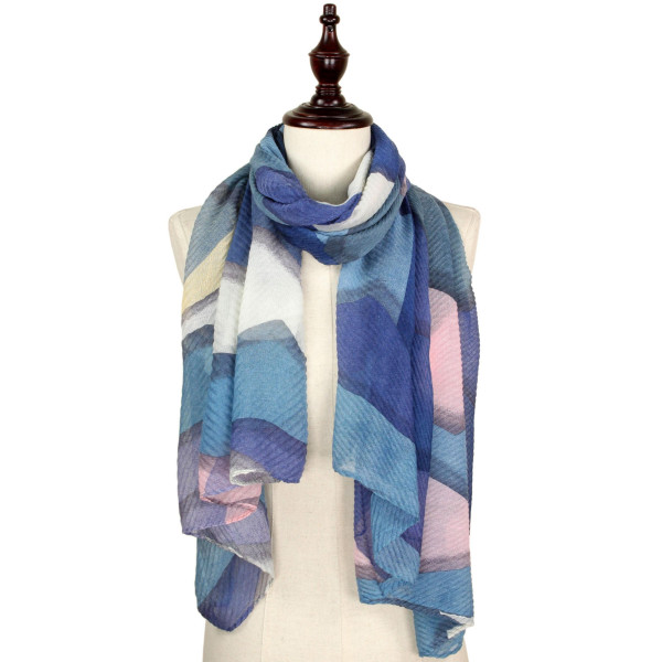 Abstract print pleated scarf. 100% polyester.