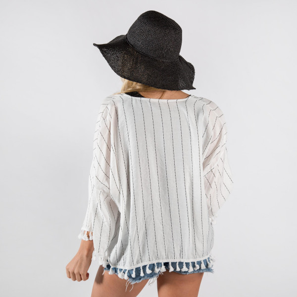 Striped cardigan with tasseled trim. 60% cotton-40%polyester.