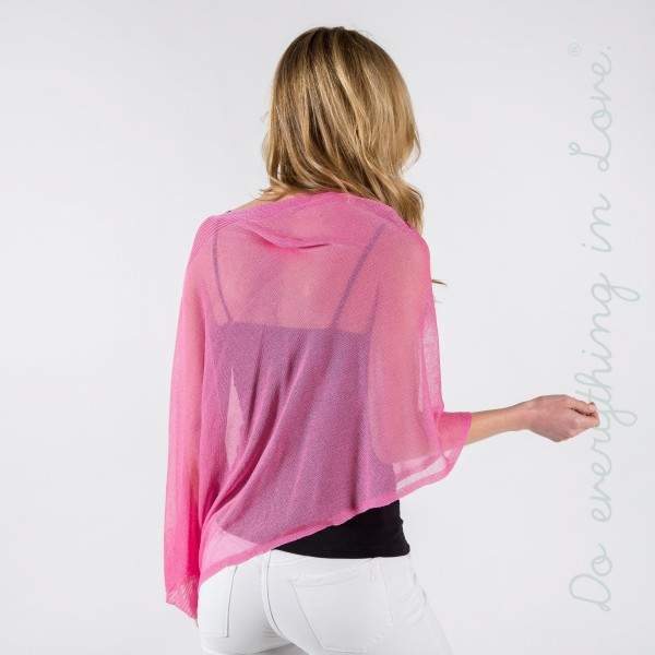 Sheer asymmetric knitted poncho. 85% viscose- 15% polyester.