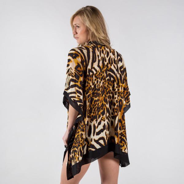 Sheer animal print bordered kimono 100% viscose.