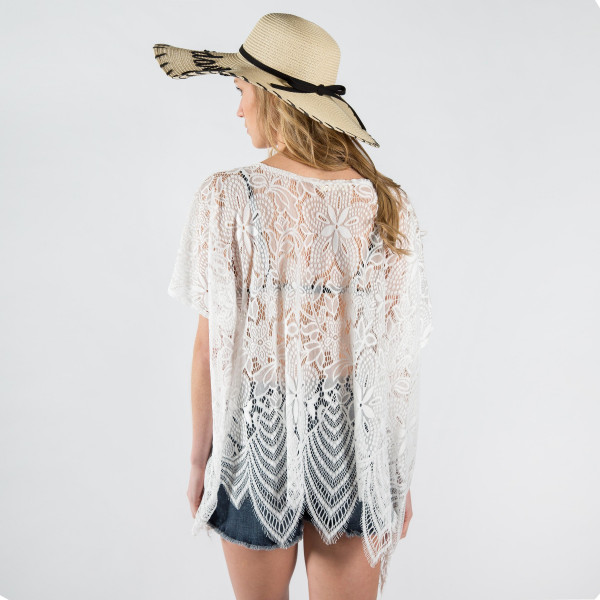 Floral print lace cover up. One size fits most 0-14. 100% polyester.