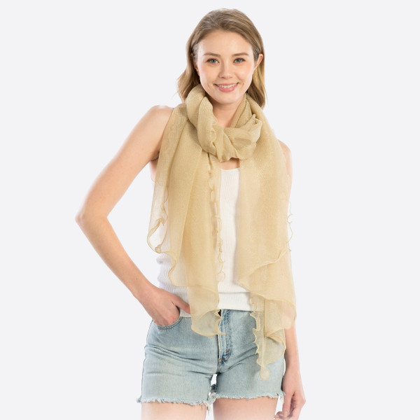 "Solid colored scarf with metallic detail. 100% Polyester. Measuring approximately 32"" x 72"" in length."