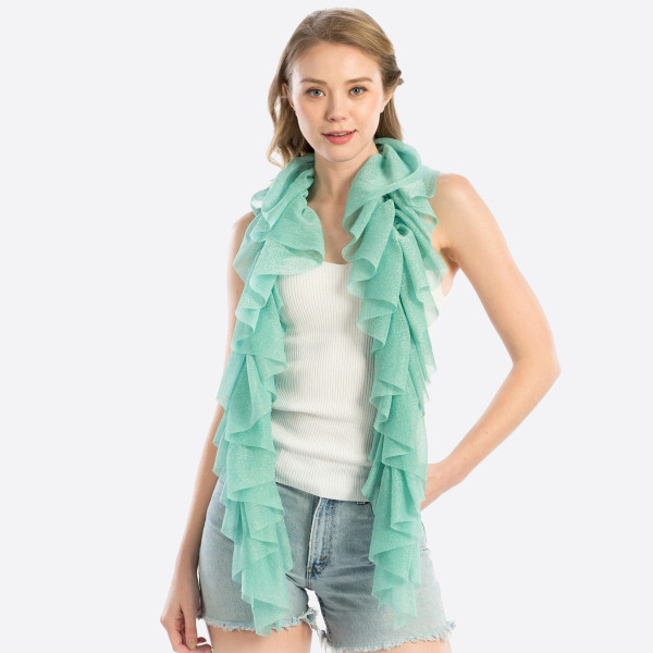 "Solid colored scarf with metallic detail. 100% Polyester. Measuring approximately 13"" x 55"" in length."