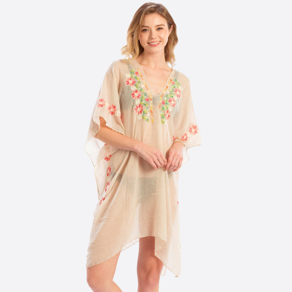 """Lightweight, sheer embroidered poncho / swimsuit cover up. 50% Polyester, 50% Viscose. Approximately 71"""" in length. One size fits most 0-14."""