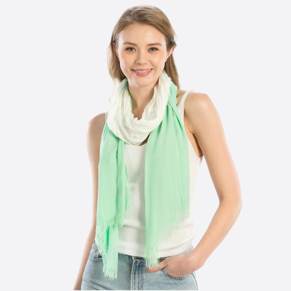"Lightweight mint hombre scarf. Measures approximately 40"" x 74"" in length. 100% Modal."