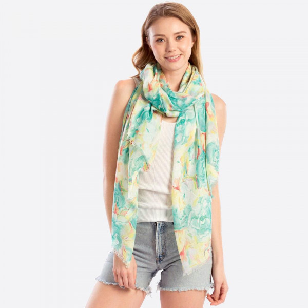 "Light weight scarf with floral print. Approximate 70""x40"" in length."