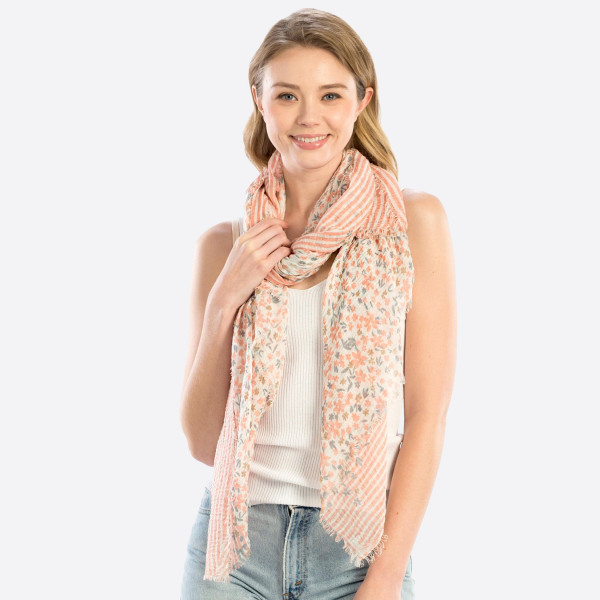 "Lightweight flower printed scarf. 100% polyester. Measuring approximately 36"" x 70"" in length."