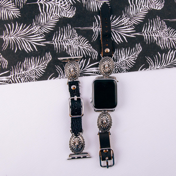 """Black faux leather smart watch band featuring a flower inspired charm. Fits 38/40 mm size watch face. Approximately 6"""" in length. WATCH NOT INCLUDED."""