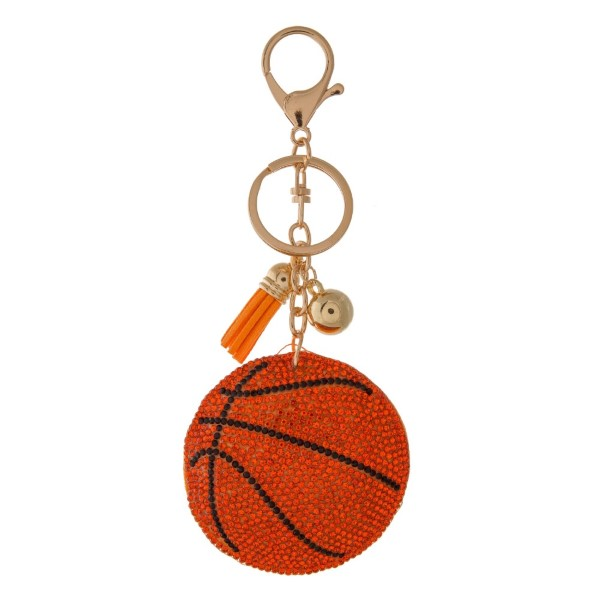 "Keychain with sports ball design. Approximately 4.5"" in length."