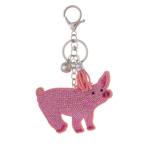 "Keychain with faux suede tassel and rhinestone pig. Approximately 2.5"" in diameter."