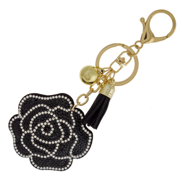 """Flower keychain with faux suede tassel and rhinestone softball. Approximately 2.5"""" in diameter."""